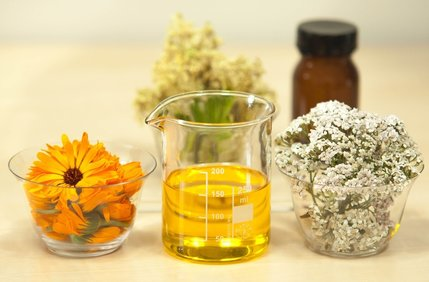 Herbs, flowers, and liquids in glass vials and bottles