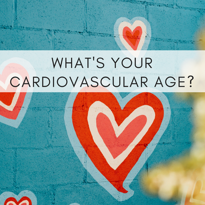 "Photo of a turquoise brick wall with red hearts painted on it with caption reading ""What's your cardiovascular age?"""